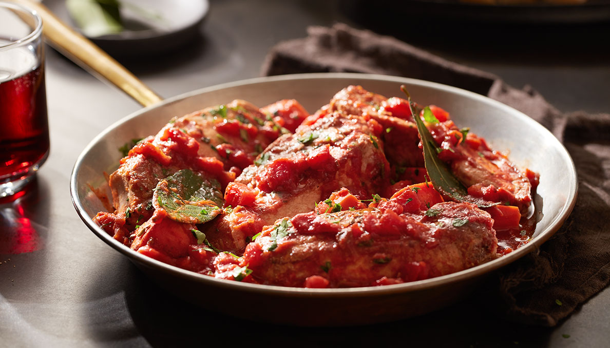 Image of Red Gold Tomatoes recipe Braised Country Style Pork Ribs with diced tomatoes in a skillet