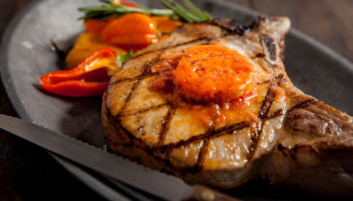 Tomato butter on grilled pork chop