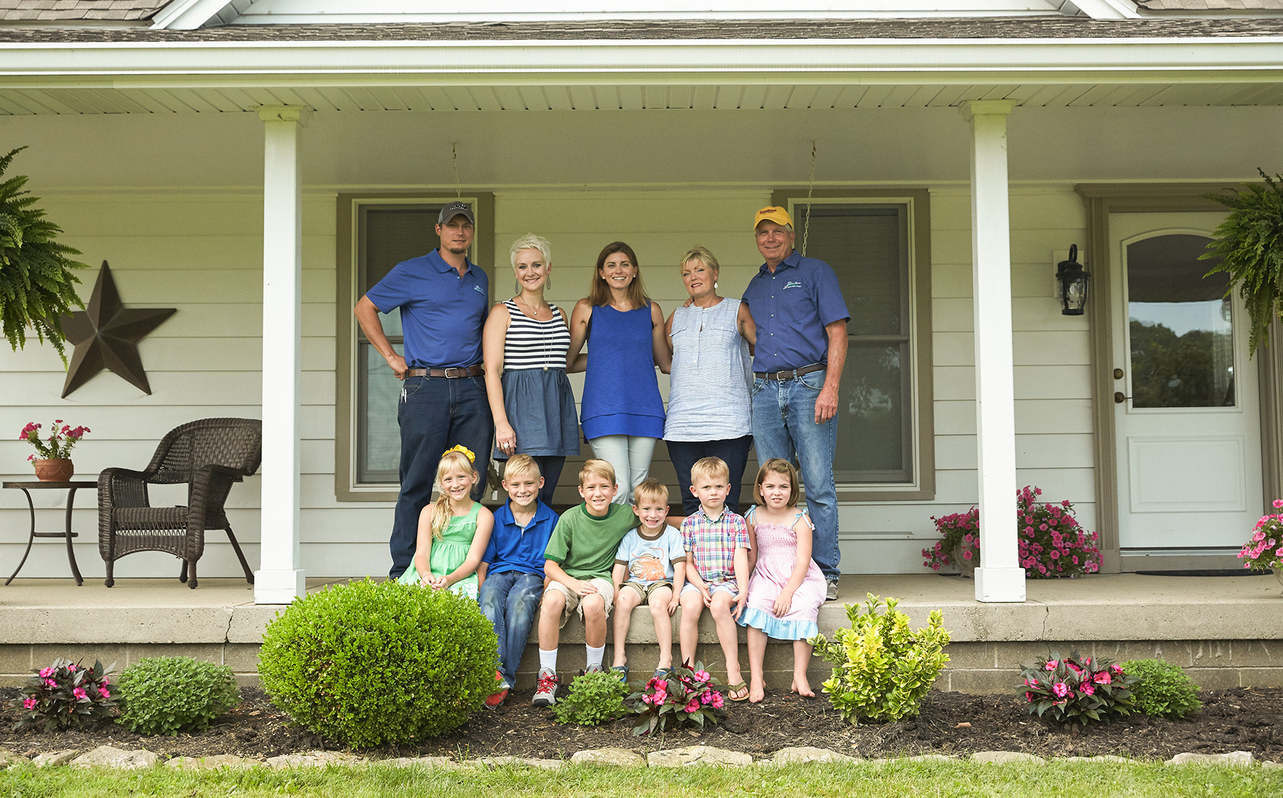 Image of Gelfius Family Farms Growers for Red Gold Tomatoes from Hartsville Indiana standing on front porch