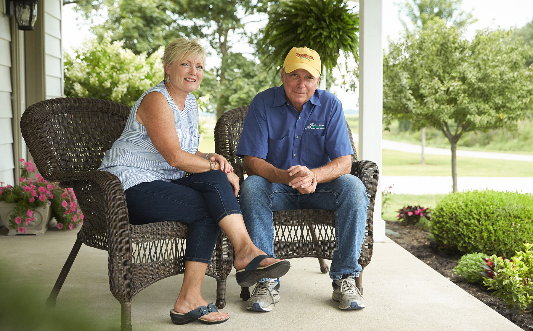 Image of Gelfius Family Farms Growers for Red Gold Tomatoes from Hartsville Indiana Bill and Norma Gelfius sitting in wicker chairs on front porch