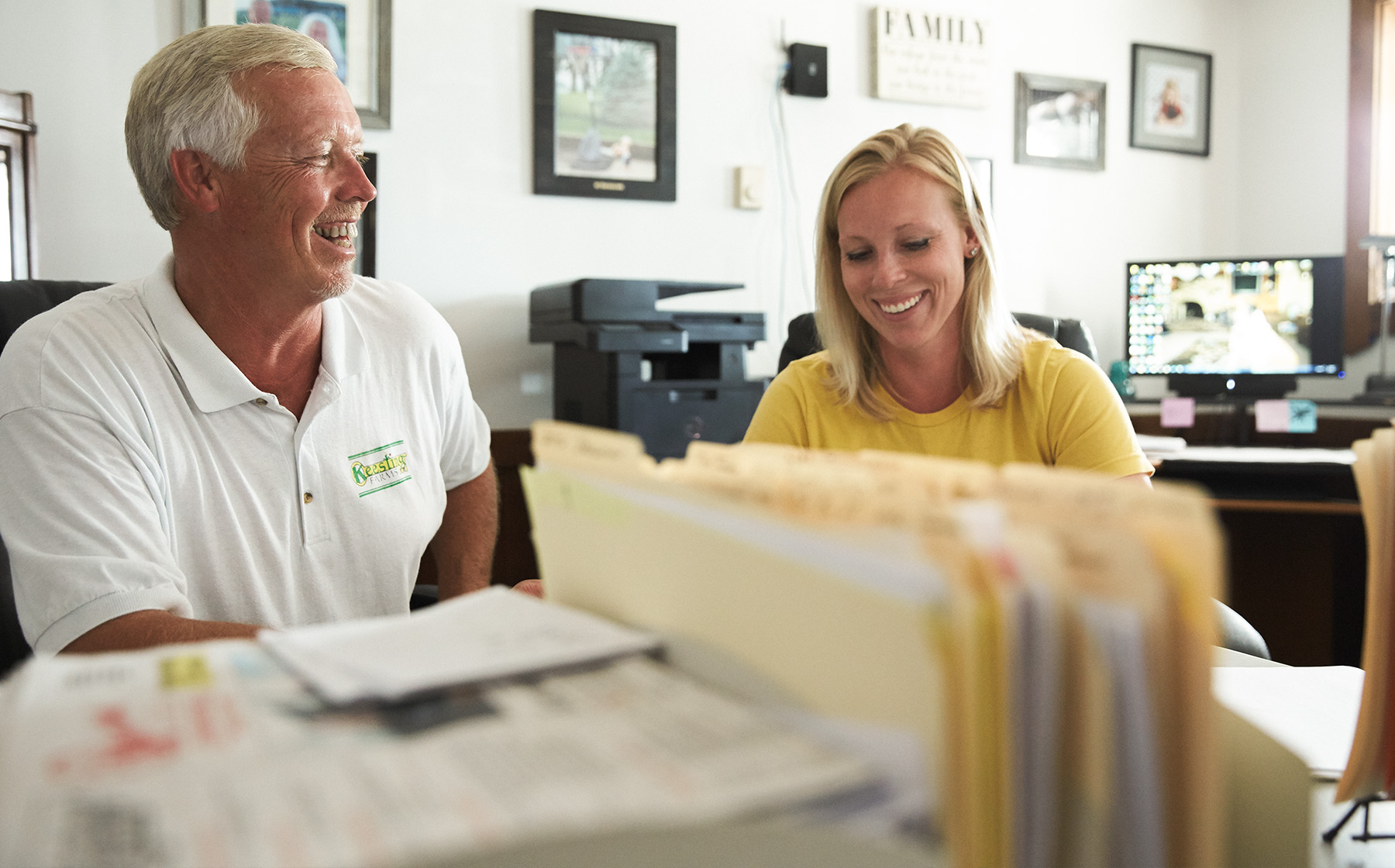 Image of Keesling Farms Growers for Red Gold Tomatoes David and daughter Kaycie in farm office