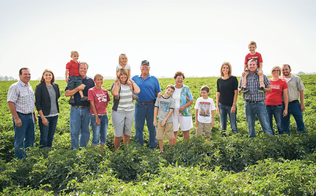 Image of Red Gold tomato growers the Middlesworth Family from Marion Indiana family standing in tomato field