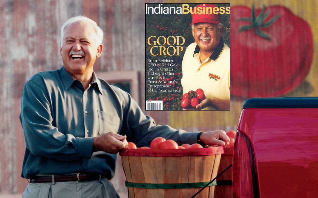 Image of Brian Reichart with bushel of tomatoes and Indiana Business magazine
