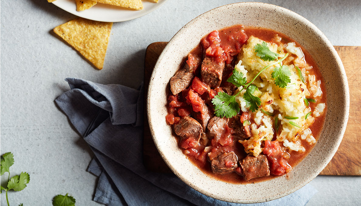 Image of salsa beef chili with tortilla chip beef chunks