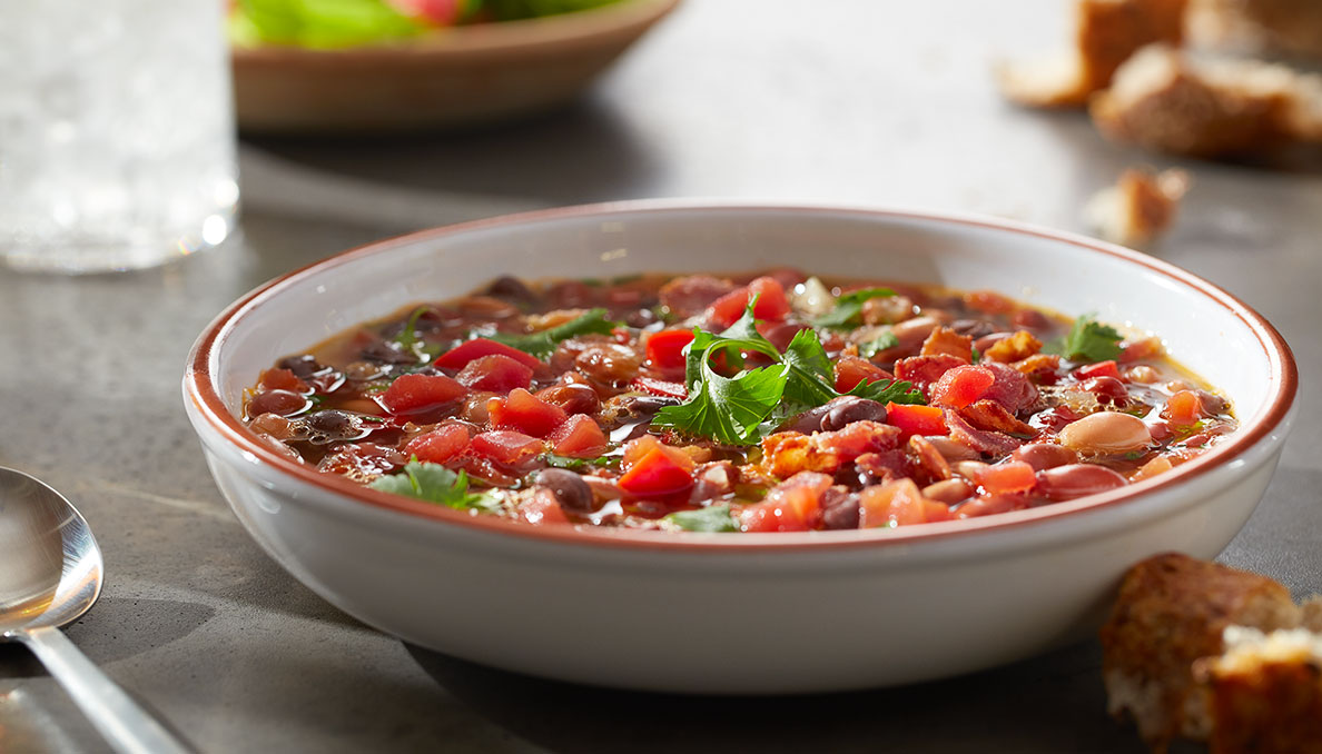 Image of savory bean soup in bowl using canned petite diced tomatoes