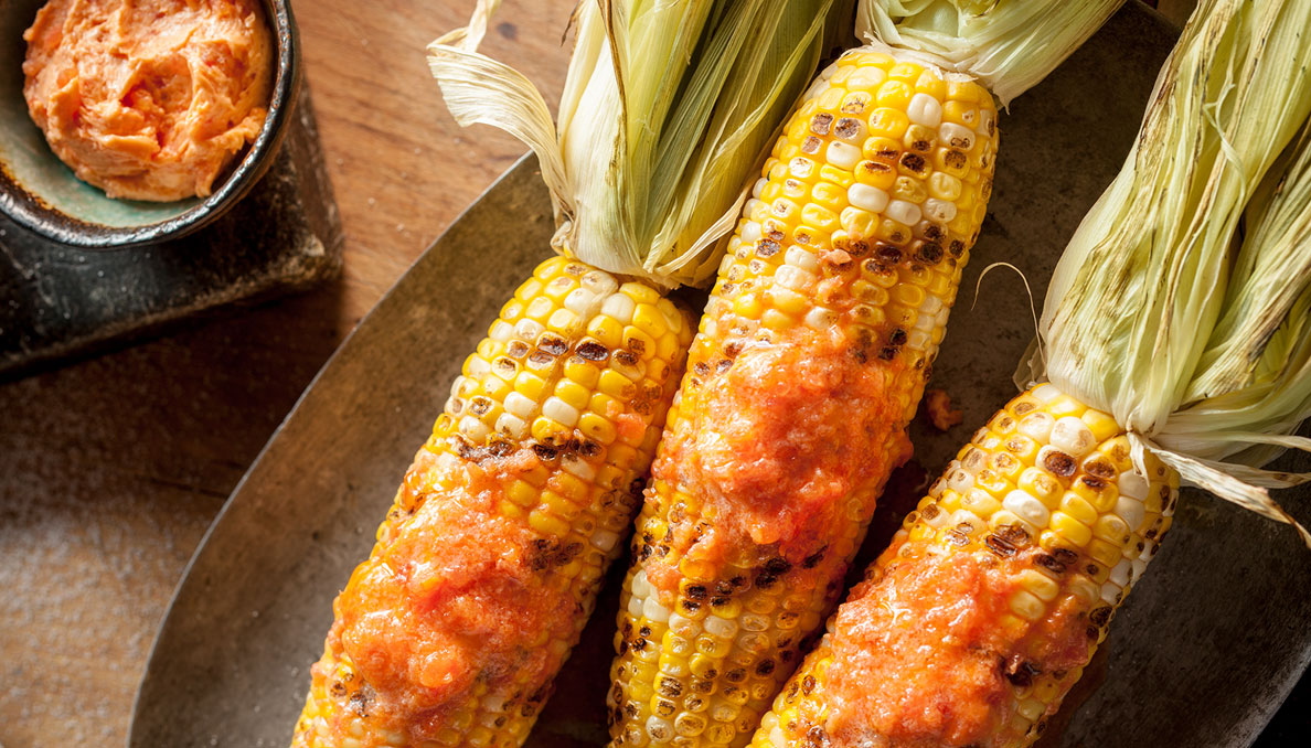 Tomato buter meleted on corn